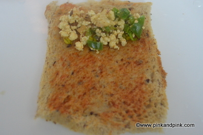 Paneer Bread Roll Recipe - Spread the paneer stuffing on the bread slice