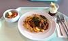 Pork steak with fried onions, red wine sauce & roast potatoesHolzfällersteak mit Röstzwiebeln, Rotweinjus & Bratkartoffeln