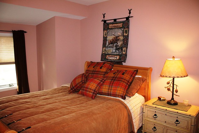 Master bedroom with queen size bed, full closet and big screened TV;