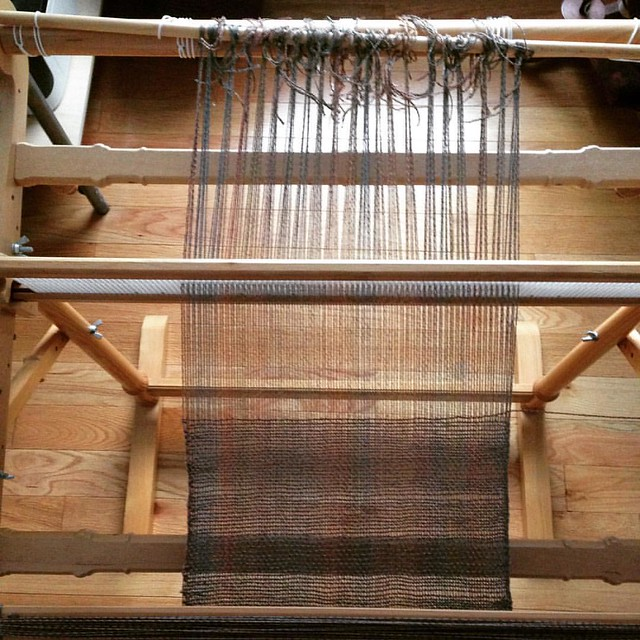 After a ridiculously long hiatus, I'm finally going to get this off the loom. Hemstitching the ends and tying knots for fringe.
