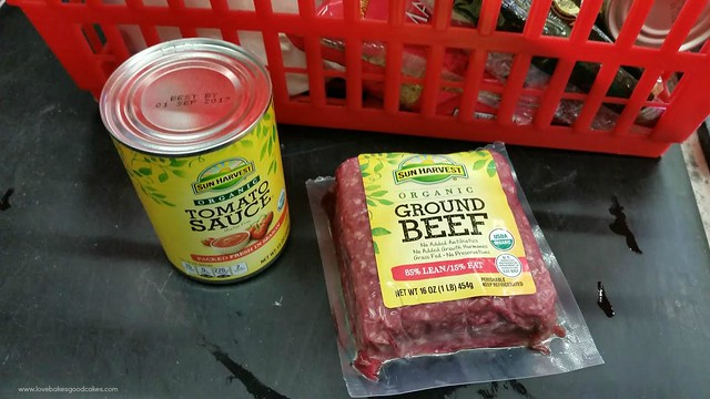A can of Sun Harvest tomato sauce and a pound of ground beef.