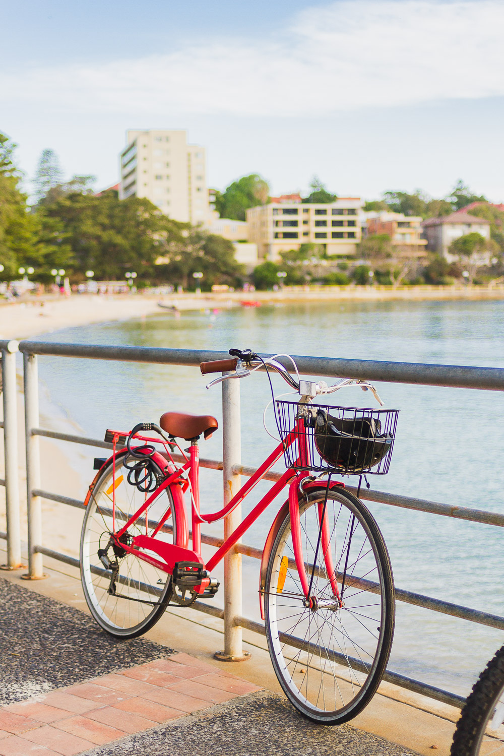 bright red bike manly beach