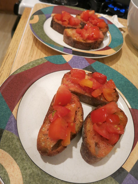 Tomato and anchovy crostini