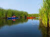 Kayakers navigate a channel between ponds at Lakeview Wildlife Management Area. by snapify
