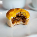 Cross section of baked barbecued pork bun with pine nuts