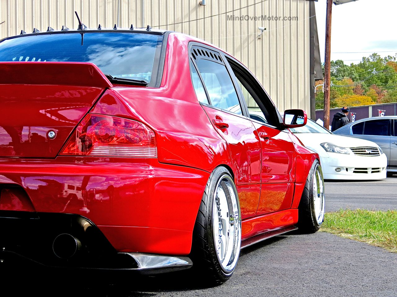 Stanced Red Mitsubishi Evo First Class Fitment 2