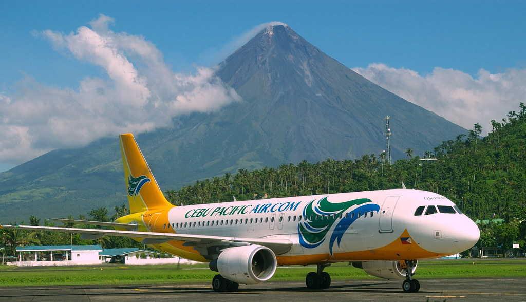 Mayon Volcano (Mount Mayon) and Cebu Pacific Air Airbus A320, view from Legazpi airport, province of Albay, Philippines