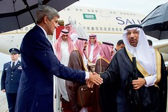 U.S. Secretary of State John Kerry greets a Saudi official at Andrews Air Force Base in Camp Springs, Maryland, on September 3, 2015, during a ceremony to welcome King Salman bin Abdulaziz of Saudi Arabia for a visit with President Barack Obama. [State Department photo/ Public Domain]