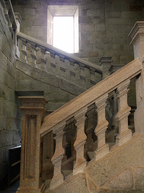 The staircase in the converted monastery at Parador de Santo Estevo leads up to a wonderful permanent art show.