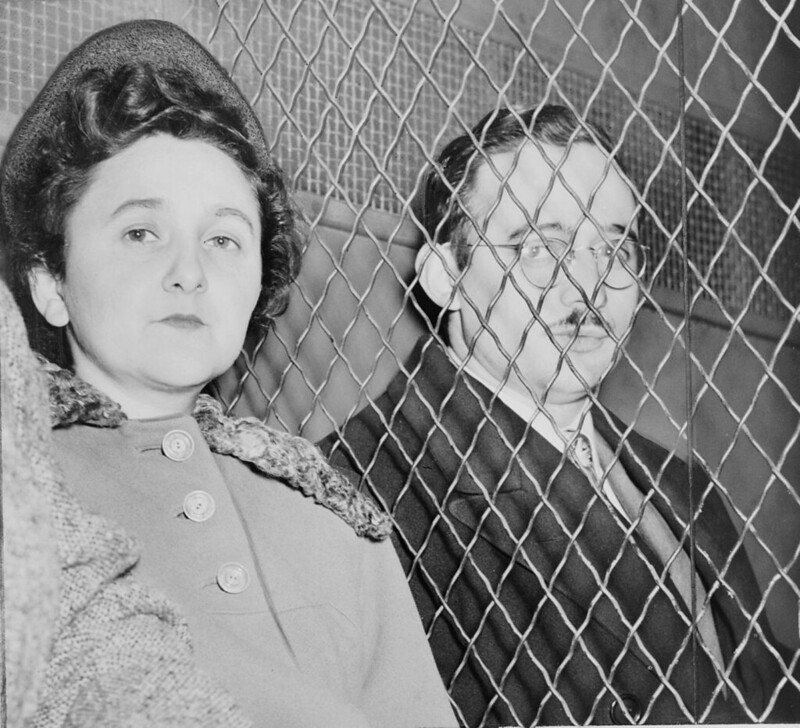 Julius and Ethel Rosenberg, separated by heavy wire screen as they leave U.S. Court House