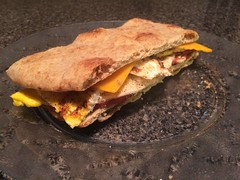 Fried balogna, egg, and cheese on flatbread