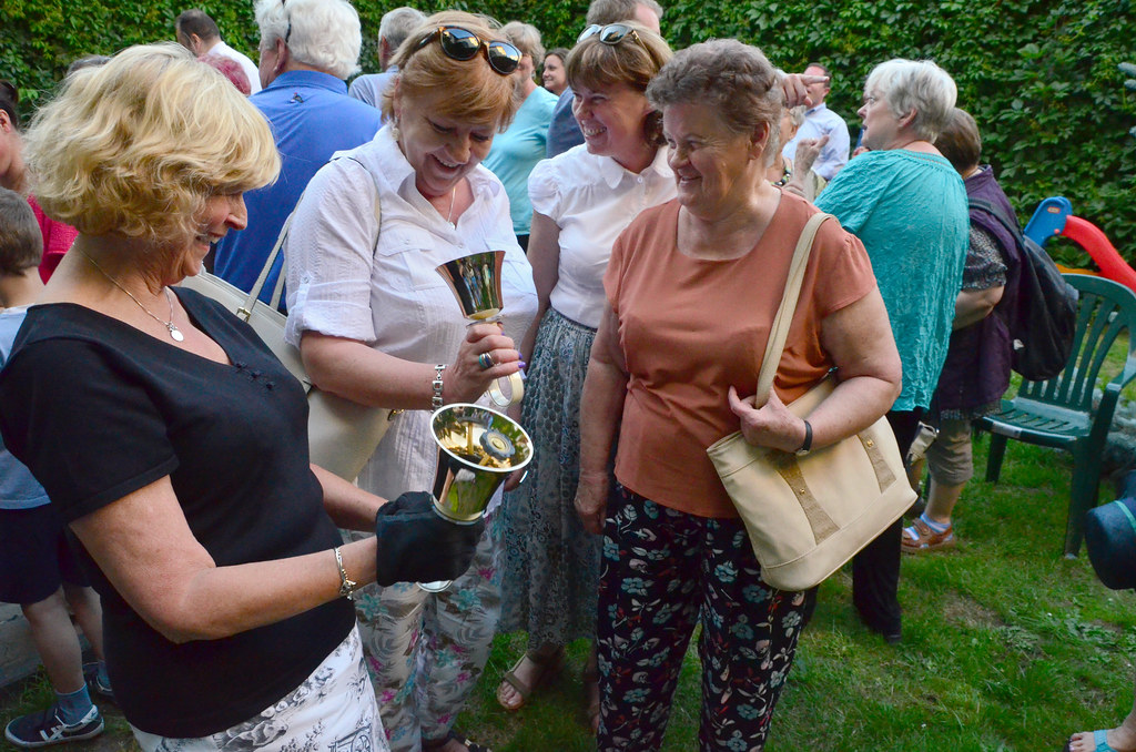 Davidson UMC Handbell Choir members share their handbells with locals after Davidson's concert in the Evangelical Methodist Church in Krakow