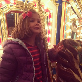 Riding the holiday carousel at the mall.