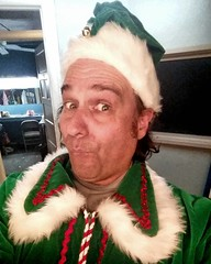 It's Droppo! The silliest elf at the North Pole! He's helping Santa in 'T'was the Night Before Christmas'!