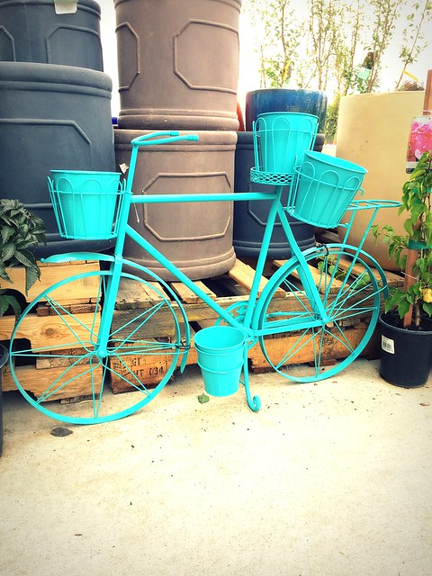 teal bicycle plant holder