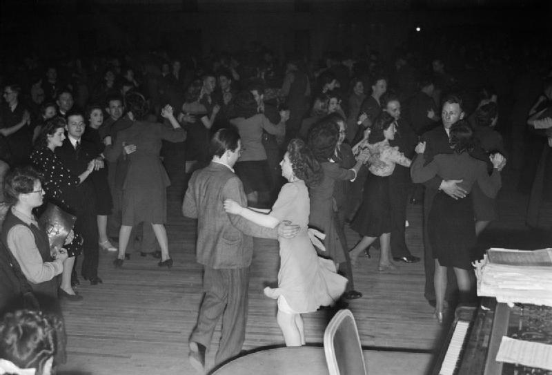A couple at a British dance hall try out the new 'jive' steps, whilst the rest of the hall continue with 'old-style' ballroom dancing, 1945.