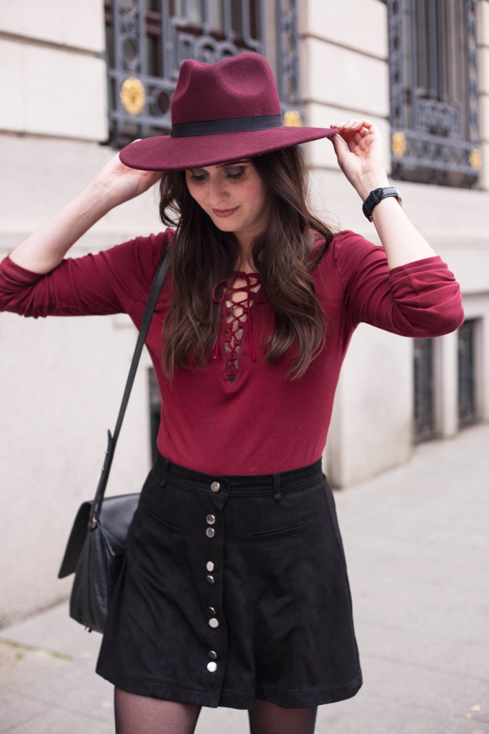 outfit: burgundy hat, lace up top, button down skirt