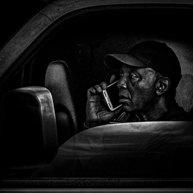 Stuck In Rush Hour Traffic With His Trusty Smart Phone, Martin Luther King Jr. Avenue, Historic Anacostia, Washington, DC.psd