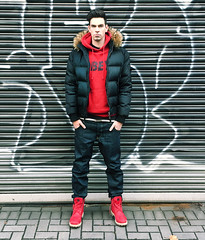 Young Male Fashion Guy in Hoodie and Downjacket  0dbcbd34a