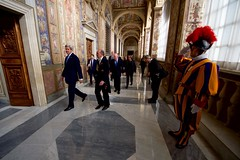 A member of the Swiss Guard salutes on December 2, 2016, as U.S. Secretary of State John Kerry departs from the Vatican following a meeting with Pope Francis. [State Department photo/ Public Domain]