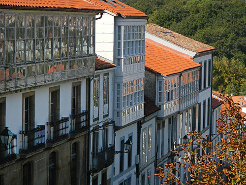 Glassed-in balconies are a common feature on the buildings of rainy Santiago de Compostela, Spain