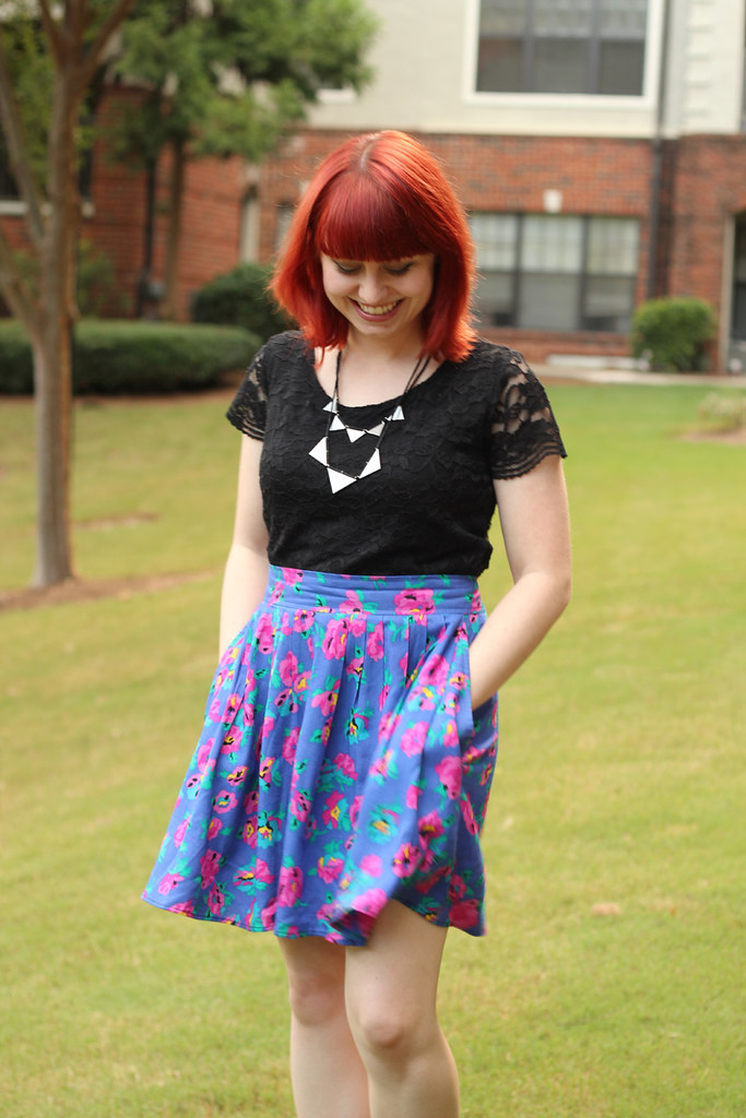 Bright Red Hair, Silver Triangles Necklace, Lace Shirt, and a Vintage Floral Print Skirt