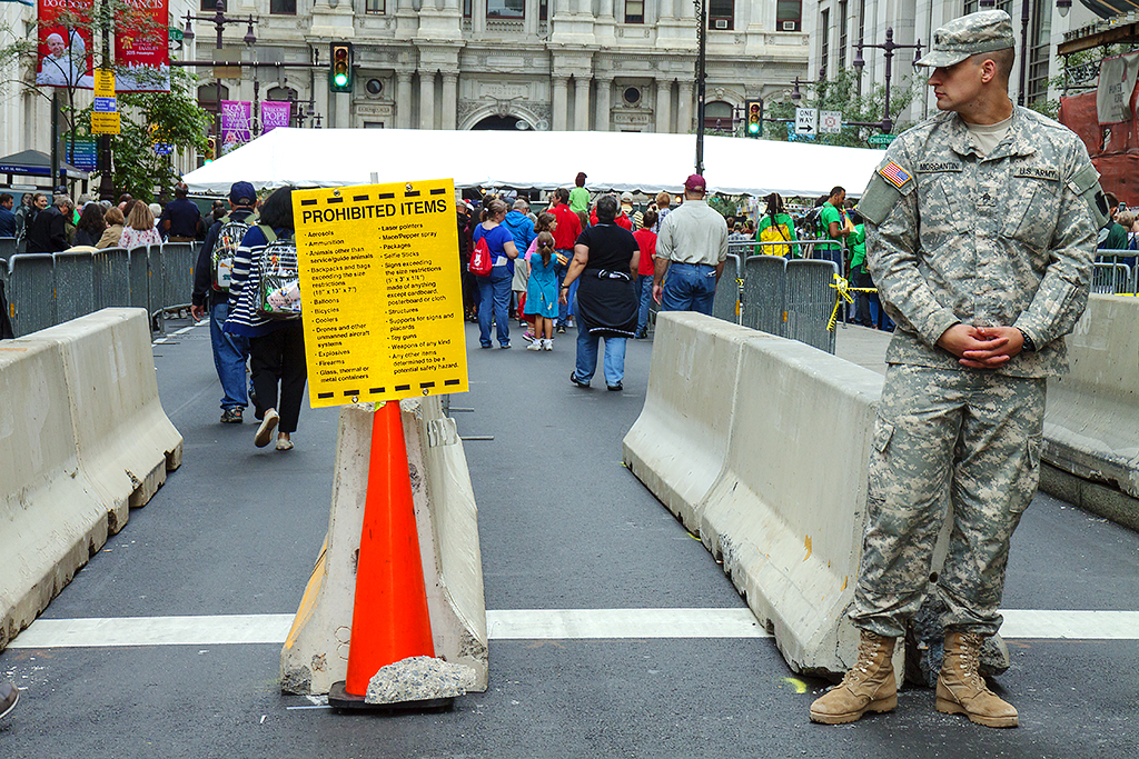 Soldier at security check point for Pope Francis' visit--Center City