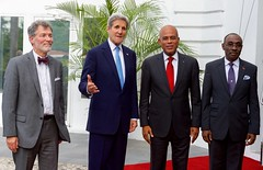 U.S. Secretary of State John Kerry poses for a photo with U.S. Ambassador to Haiti Peter Mulrean, Haitian President Michel Martelly, and Haitian Prime Minister Evans Paul before their  meeting at the Presidential Palace in Port-au-Prince, Haiti, on October 6, 2015. [State Department photo/ Public Domain]