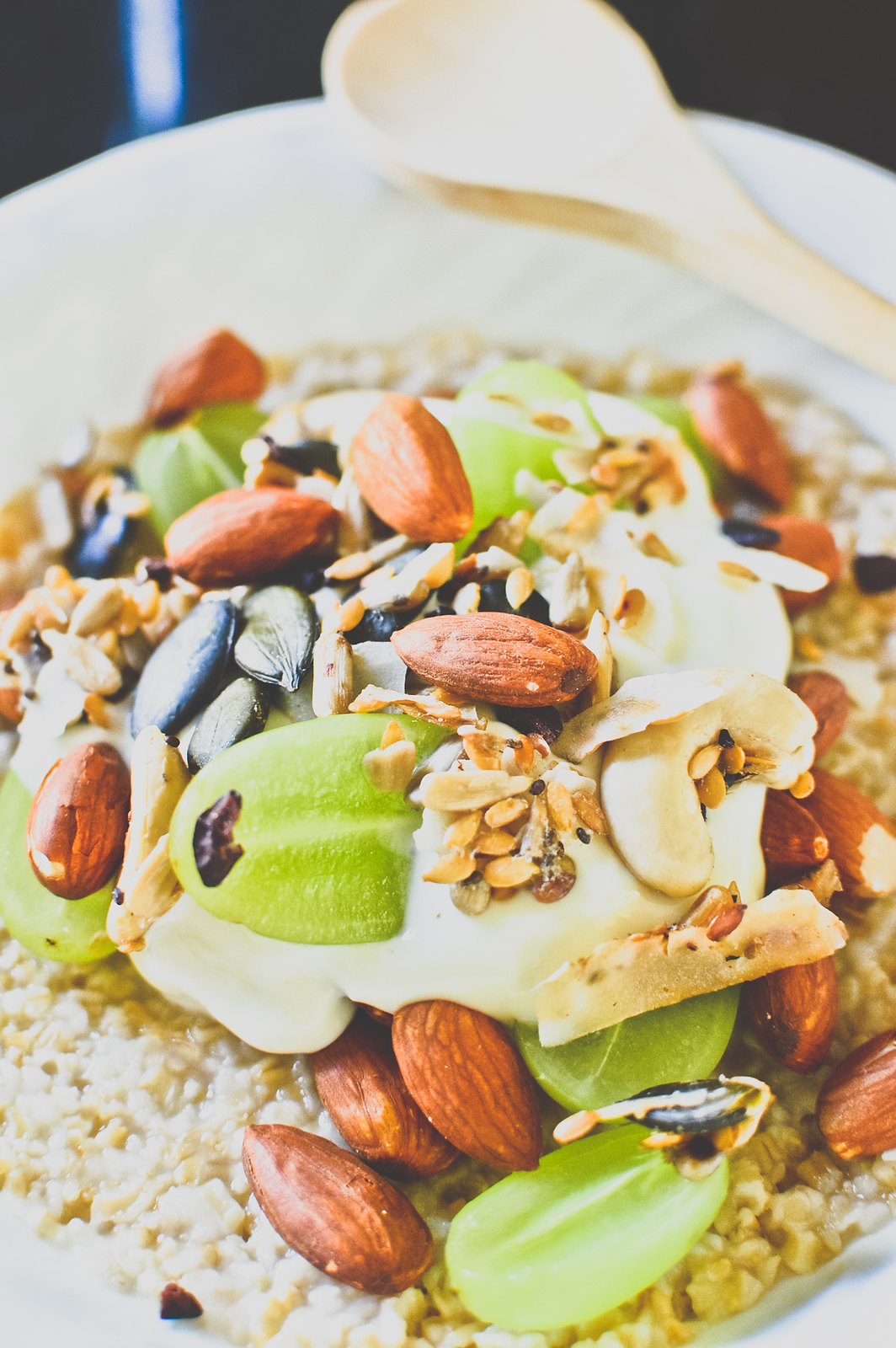 Steel-Cut Oat Porridge with Honey, Roasted Almonds, Green Grapes and Greek Yogurt
