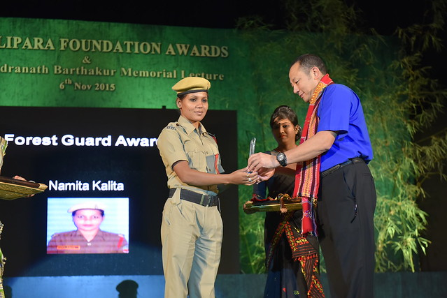 Ms. Namita Kalita, Winner of 2015 Special Award, Forest Guuards Award receiving the award from Mr. Sonam Wanchuk, Head of Wildlife & Forests, Bhutan