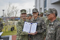 Rear Adm. Brad Cooper presents a Flag Letter of Commendation to a Republic of Korea Navy sailor during the first Navy Alliance Awards ceremony. (U.S. Navy/PO3 Wesley J. Breedlove)