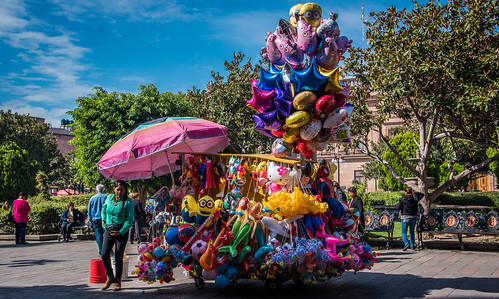 2016 cropped mexico nikon nikond750 nikonfx sanluispotosi tedmcgrath tedsphotos tedsphotosmexico vignetting balloons sanluispotosiphotos pail bucket red redrule benches seating seated seat park plazadearmas plazadearmassanluispotosi denim shadows shadow outdoor parkbench parkscene cityview people peopleandpaths umbrella