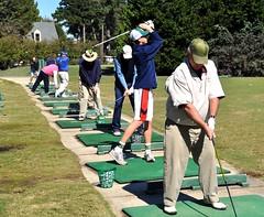 Wildwood Green golfers warming up on the driving range.