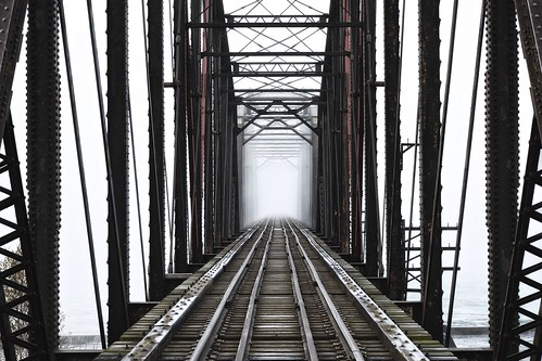 railroad bridge autumn mist ontario rain weather fog architecture danger unitedstates michigan traintracks railway notrespassing saultstemarie bleachbypass stmarysriver circa1887 canadiannationalrailway unitedstatesborder nikcolorefex canadaborder dominionbridgecompany camelbacktruss internationalrailroadbridge xf55200mm fall2015