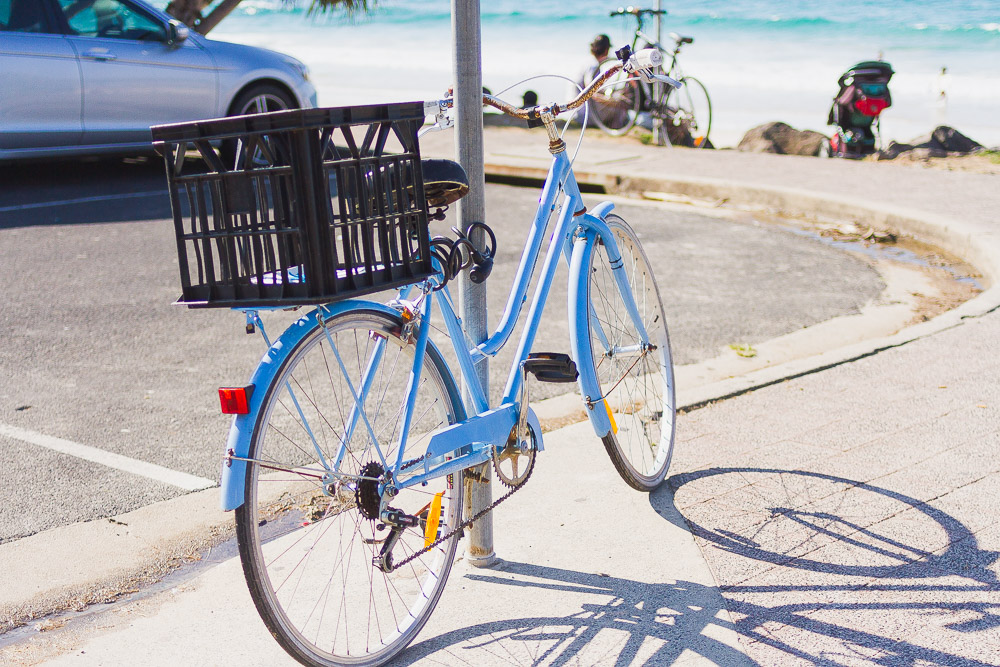 blue bike by the beach byron bay australia