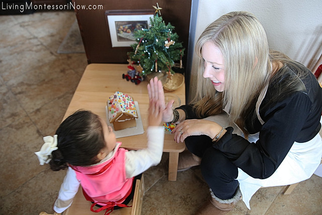Giving a High Five after Finishing the Gingerbread House