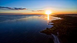 Image of Playa agreste Puerto Platero. light sunset sky sun tree green beach clouds landscape harbor sand aerial urbanexploration drone dji