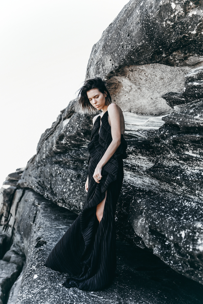 editorial new years eve all black outfit inspo Michael Lo Sordo pleated gown beach modern legacy (1 of 1)