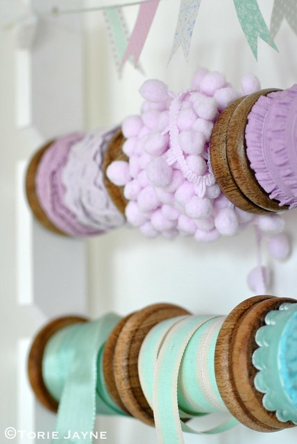 Wooden spools of pretty pastel ribbon