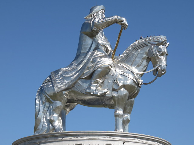 chinggis statue with people-bristles in the horse's mane