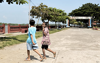 Image of Bantayan Park. road park city boy girl crossing philippines running bantayan bago