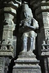 Parvatharajan worshipping Shivalinga