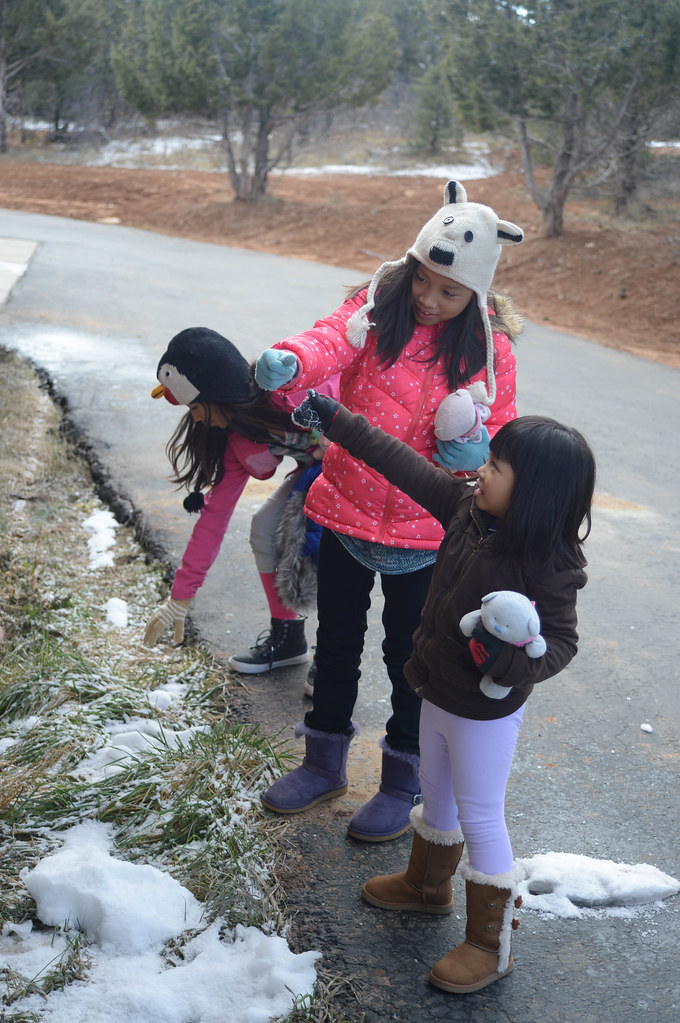 the girls playing with snow (actually, ice)