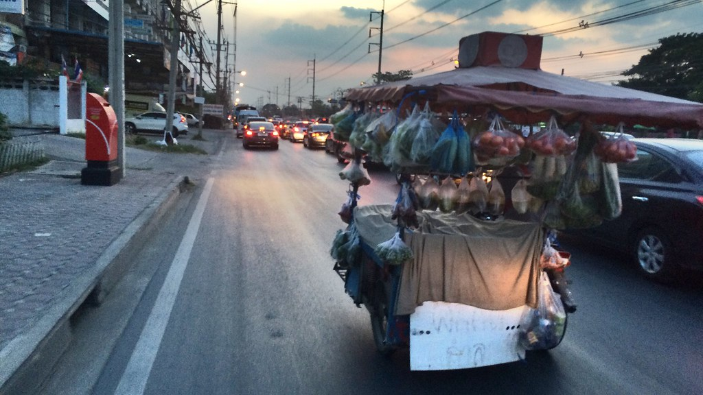 Nightfall getting to the centre of Bangkok to sell street food