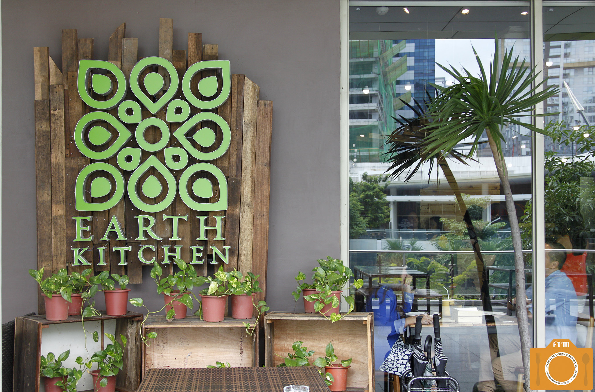 Earth Kitchen logo sign
