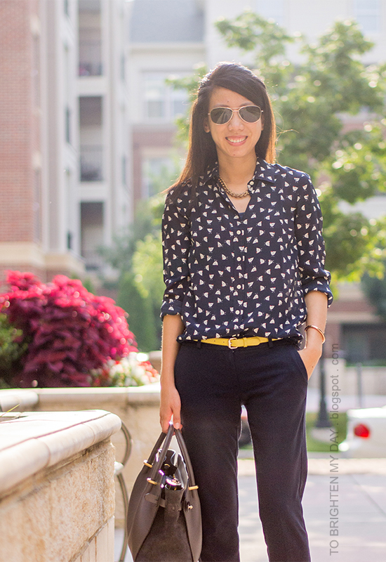 navy printed silk blouse, yellow belt, navy pants