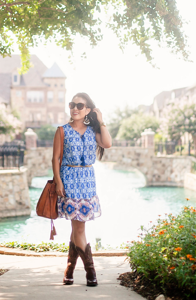 cute & little blog | petite fashion | blue vintage tile print dress, ariat heritage x cowboy boots, fringe bucket bag, statement earrings | summer fall transition outfit