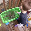 Washing sticks - they float!  #unpreschool #FergletOutside #decklife