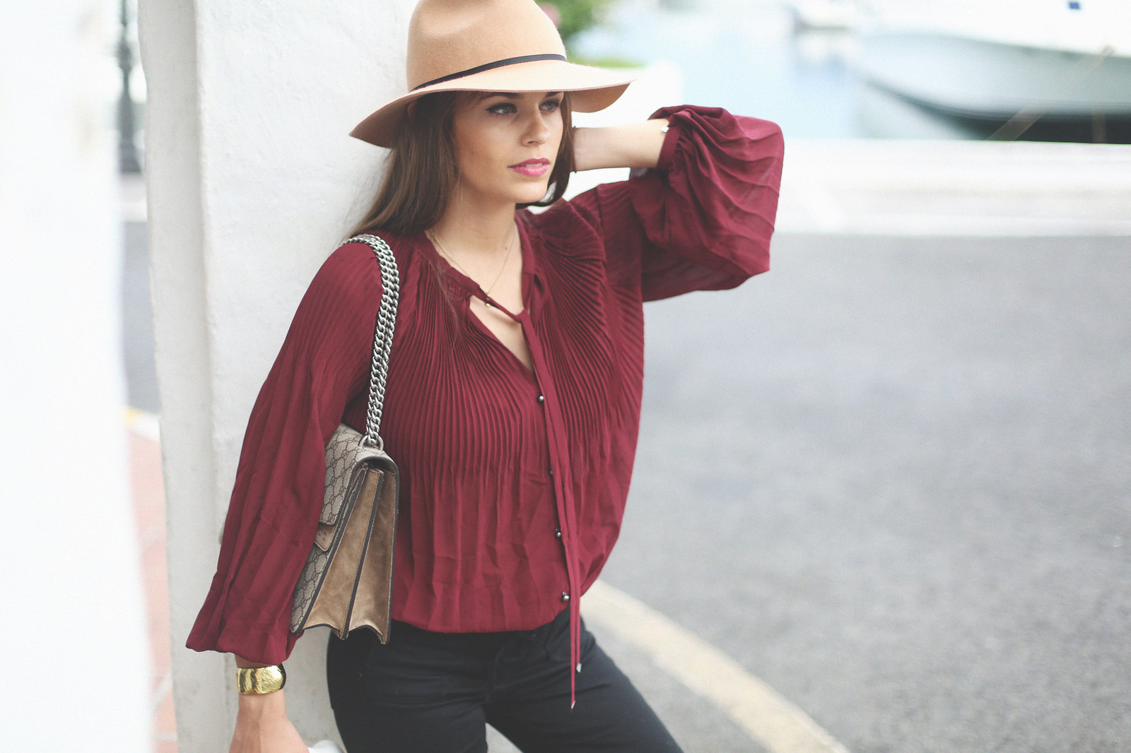 6. jessie chanes burgundy blouse cropped black jeans gucci bag