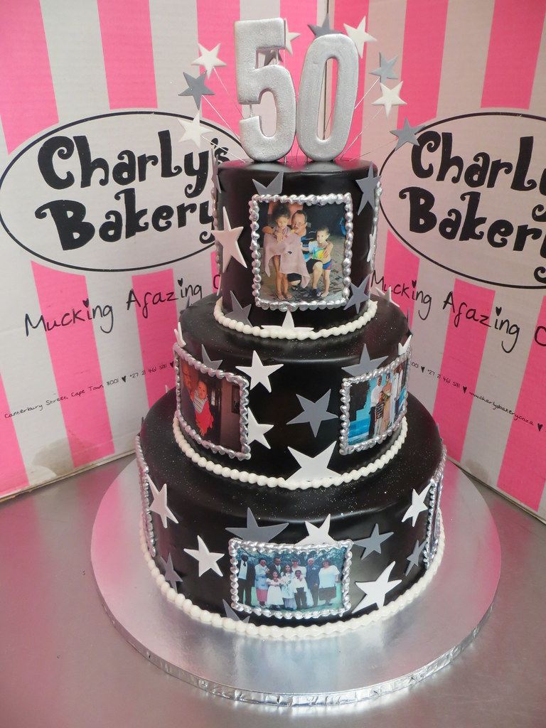3 Tier 50th Birthday Cake Iced In Black Ganache Decorated With Edible Photos Stars